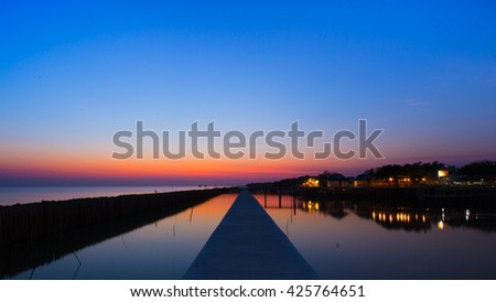 The atmosphere in the ocean at sunset. - stock photo