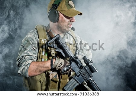 The attacking troops through the smoke after the explosion - stock photo