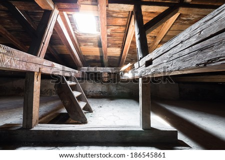 the attic of an old building, detail, low light - stock photo