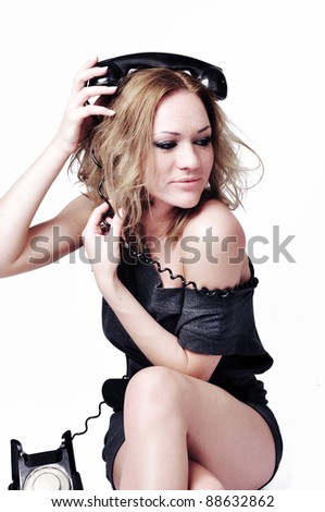The attractive and sexual woman with phone on a white background