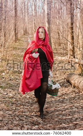 The attractive blonde woman in forest - stock photo