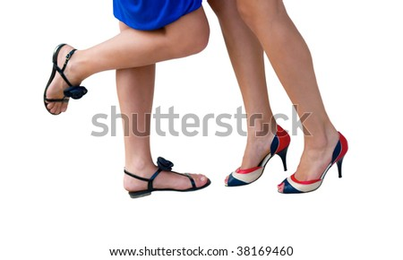 The attractive female legs isolated on a white background