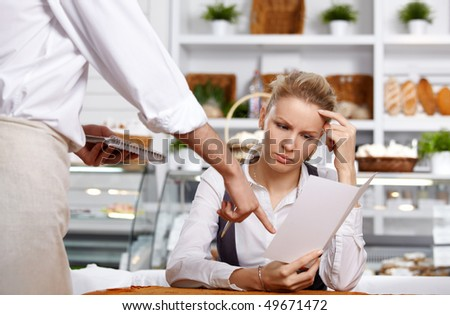 The attractive girl chooses a dish in cafe - stock photo
