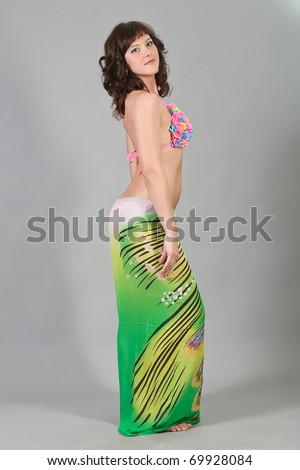 The attractive girl in beach bikini - stock photo