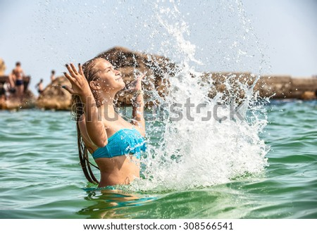 The attractive girl laying in sea