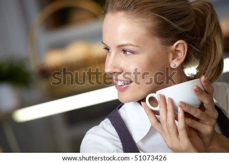 The attractive girl with a cup close up - stock photo