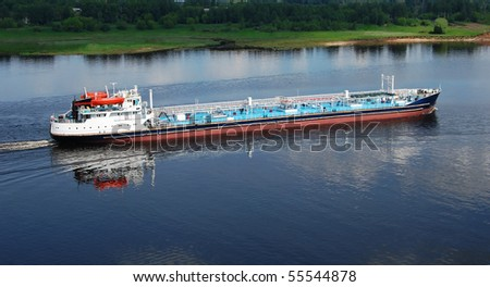 The attractive long, big barge on the river in the summer - stock photo