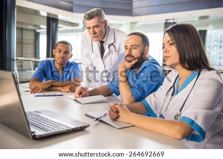 The attractive medical group working in hospital. - stock photo