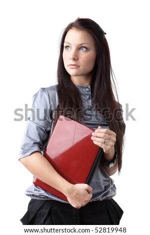 The attractive student stands with the laptop on a white background.
