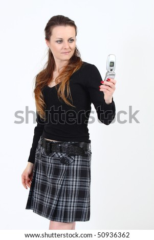 The attractive woman read sms message from mobile phone on a white background