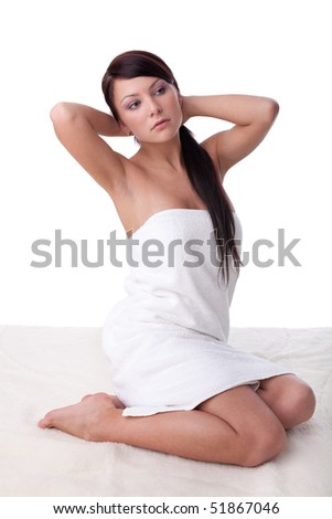 The attractive young woman in towel on a white background.  Concept spa. - stock photo