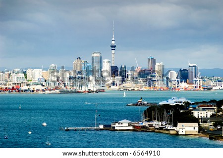 The Auckland City Skyline, with dark brooding clouds in the background - stock photo