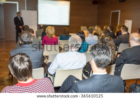 The audience listens to the acting in a conference hall