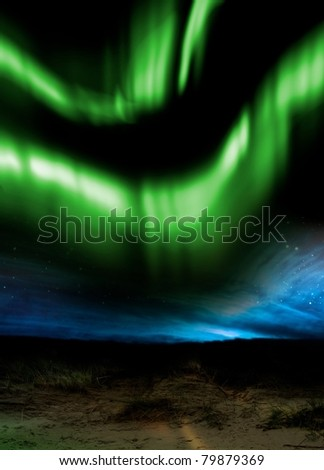 The Aurora Borealis as seen from a low viewpoint overlooking distant hills at night - stock photo