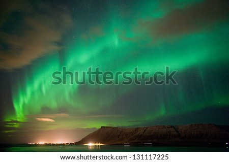 The aurora borealis or the northern lights north of Reykjavik in Iceland - stock photo