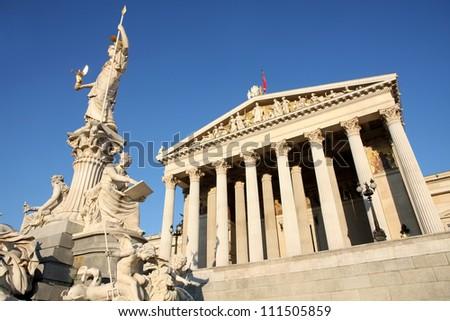 The Austrian Parliament and Athena Fountain in Vienna, Austria - stock photo