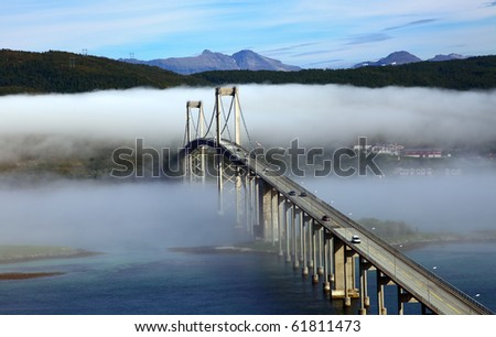 The automobile bridge in a fog