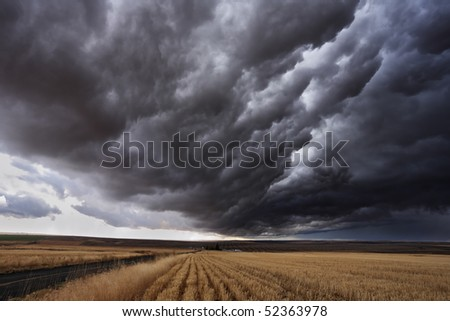 The autumn storm approaches on fields after harvesting. Montana, the USA - stock photo
