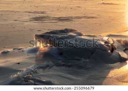 The Azov sea in winter at sunset - stock photo