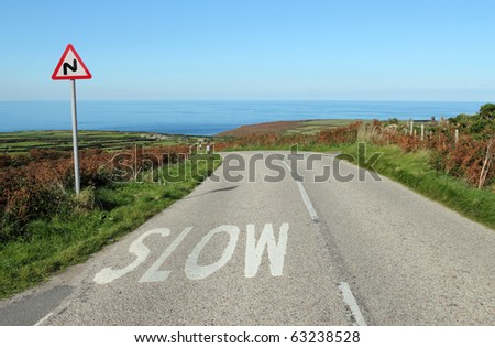 The B3306 road to the sea in Cornwall UK. - stock photo