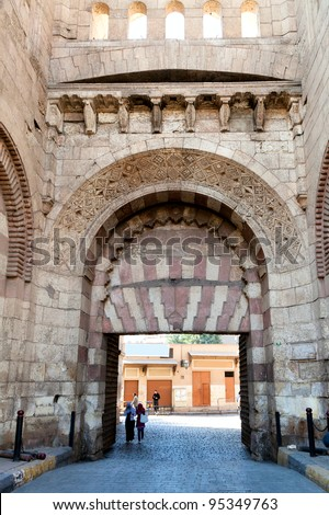 The Bab al Futuh (Gate of Conquest) is a gate in the walls of the Old City of Cairo, Egypt - stock photo