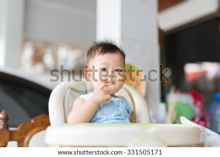 the baby boy have some meal  - stock photo