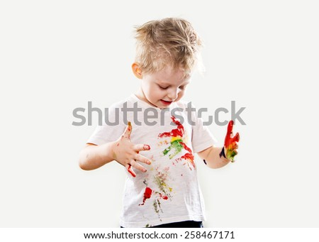 The baby boy with gouache soiled hands and shirt isolated on the white background - stock photo