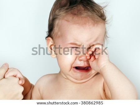 The baby cries - stock photo