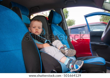 The Baby in car seat for safety, looking outside