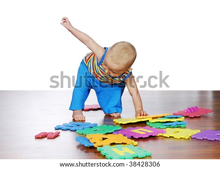 The baby is doing his first steps - stock photo