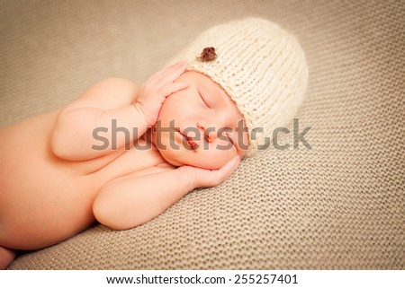 The baby sleeps on the floor - stock photo
