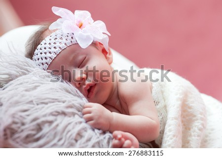 The baby sleeps peacefully - stock photo