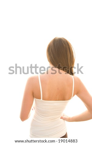The back and head of a young female - stock photo