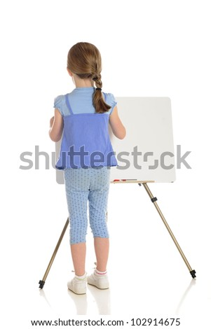 The back of a young elementary girl wrting on a white board.  The white board left blank for your message.  On a white background. - stock photo