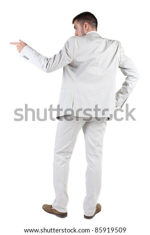 The back of businessman pointing at wall. rear view. Isolated over white .