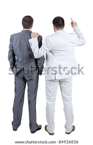 The back of two businessmen discuss. Rear view. Isolated over white background. - stock photo