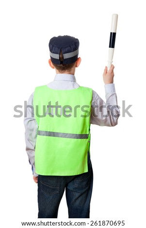 The back of young boy dressed as the State Automobile Inspector (Road patrol service) with staff, isolated on white background.  - stock photo