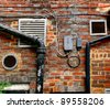 The back part of a building, pipes, grills, brickwork - stock