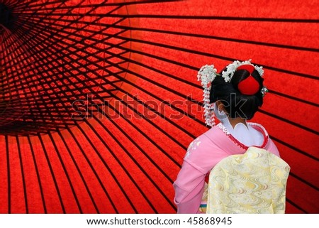 The back view of a Japanese Geisha, copy space - stock photo