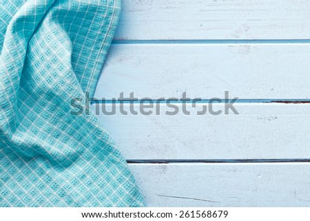 the background made from checkered napkin on blue table - stock photo