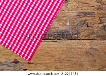 The background made from tablecloth on old wooden table - stock photo