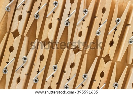 The background of a number of wooden clothespins on a wooden table - stock photo