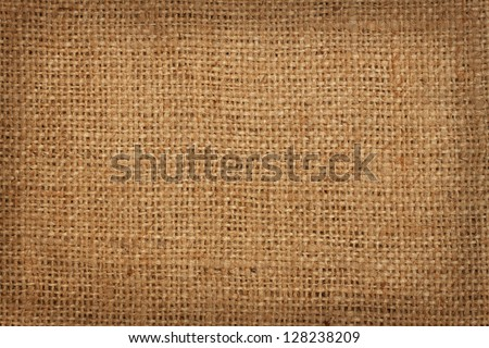The background of coarse linen burlap in a cage - stock photo