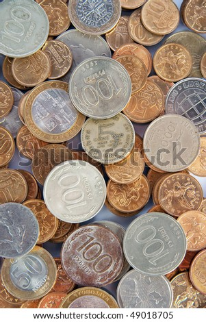 The background of the different coins - stock photo