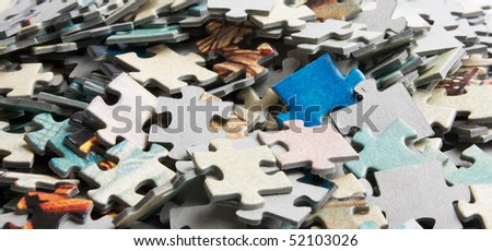 the background unsolved bunch of jigsaw puzzles pieces - stock photo