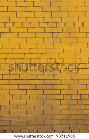 The Background with old yellow painted brick wall
