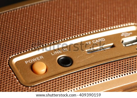 The backside of the loudspeaker shown the power button represent the speaker and sound device concept related idea. - stock photo