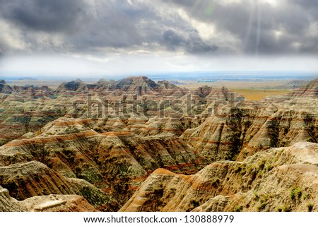 The badlands in south dakota on a stormy day - stock photo