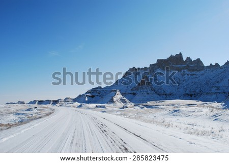 The Badlands road trip covered with snow in November - stock photo