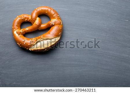 the baked pretzel on a chalkboard - stock photo